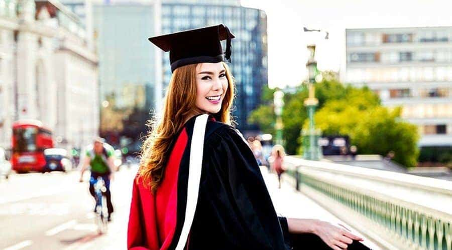 Happy female graduate following her master admission in london