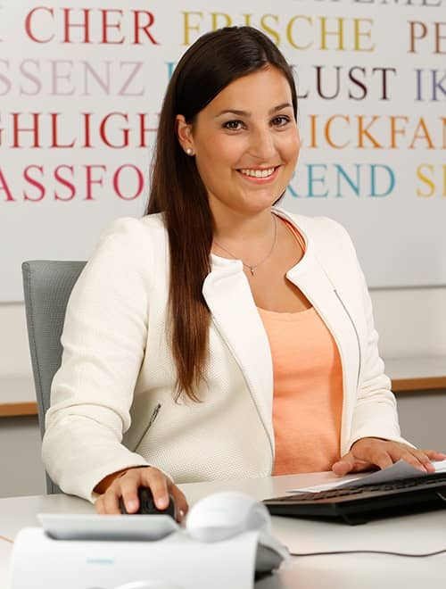 Female IELTS results agent at her desk