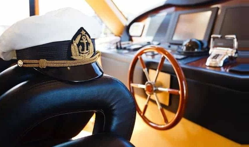 Ship cockpit with captain hat represents value of top maritime degrees and courses
