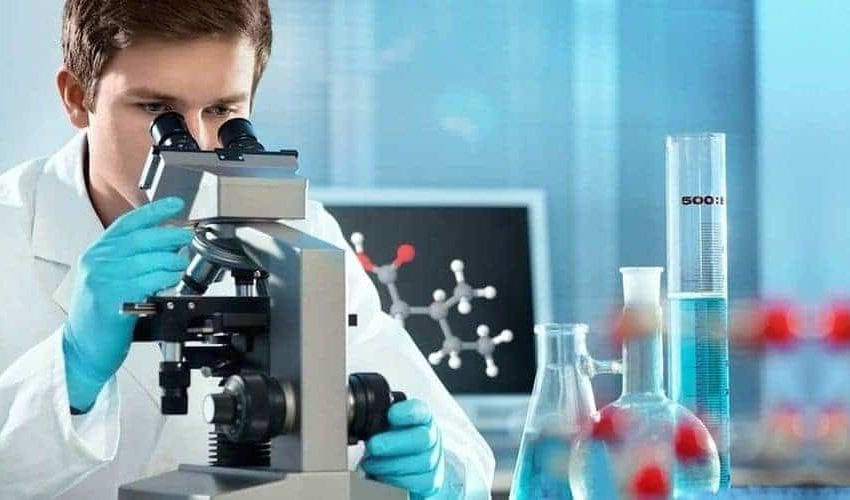 Industrial pharmaceutics degree student in science lab