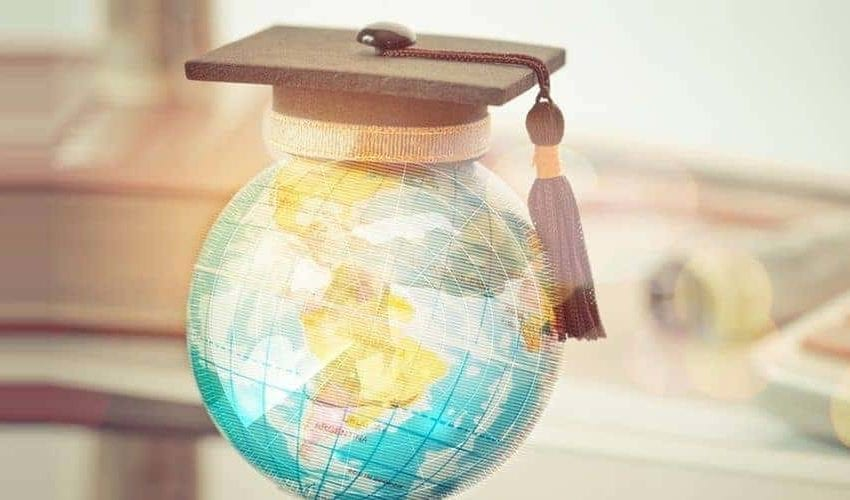Mortarboard on top of globe representing top 500 universities in the world 2020